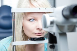 young woman having her eyes examined